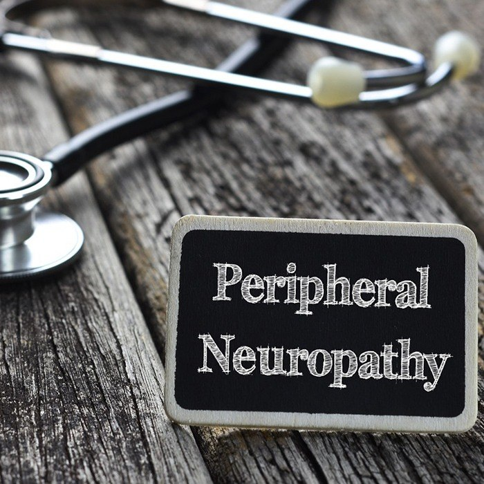 Stethoscope on table with plaque reading peripheral neuropathy