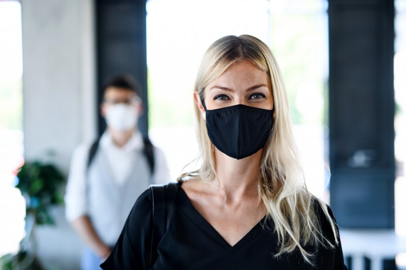 Woman in chiropractic office wearing facemask